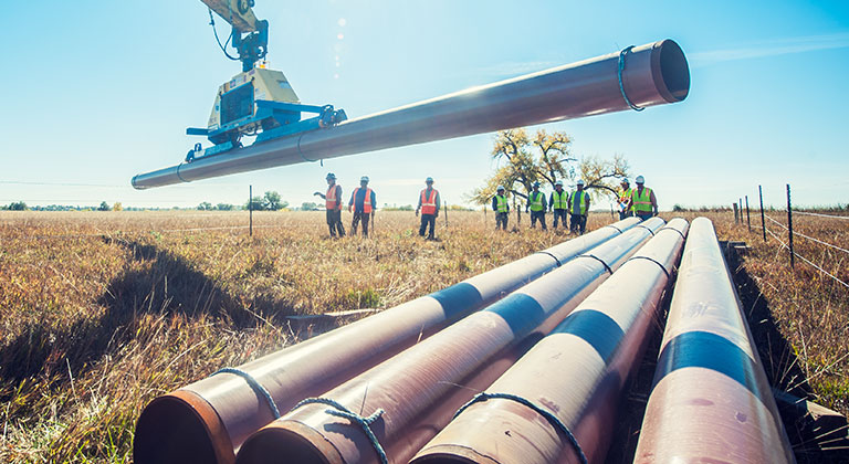 Xcel employees installing natural gas pipeline
