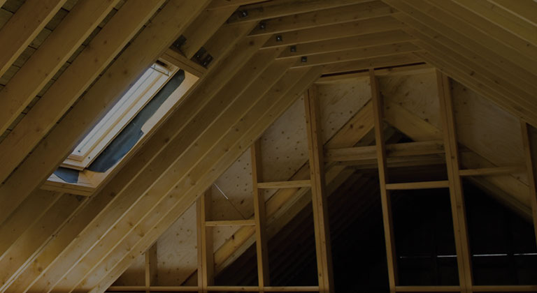 Unfinished attic with ceiling window